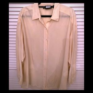 Cream colored long sleeved blouse
